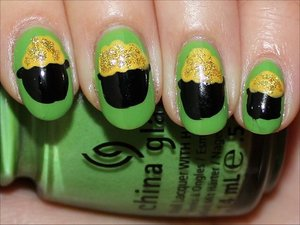 See tutorial & more photos here: http://www.swatchandlearn.com/nail-art-tutorial-pot-of-gold-nails/