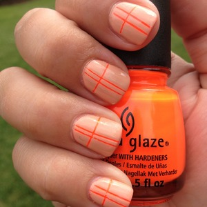 China Glaze Orange Knockout and China Glaze Sunset Sail striping tape mani  for more info see http://polishmeplease.wordpress.com