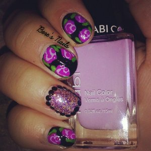 black nails with two tone purple roses. accented a nail with a glitter base and little black studs to outline!