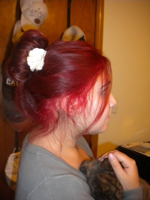 messy bun with a cute flower on the side
