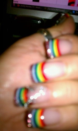 My mom's nails... Representing the LGBT community (even though she's heterosexual)!! Way to go momma! :]