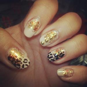 I used my new favorite nude, OPI Don't Pretzel My Buttons and China Glaze Electrify with a touch of leopard print!