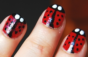 Pretty Ladybugs Nail Art Tutorial: http://www.youtube.com/watch?v=Efive1lGW7Y -I used: base coat, red, white, sparkly pink, nail art pen, top coat.  For especific brands/names please watch my tutorial.