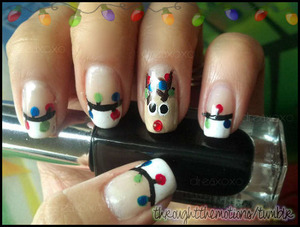 ♪ Rudolph the red nose reindeer … got tangled in some Christmas lights ♪ (hehe)  Base: Marina & Demme .:. unlabled White (tips)  Ring: Finger Paints .:. Don't Make A Scene, Avon .:. Mink, Sinful Colors .:. Nail Art Bad Chick, and Sinful Colors .:. Nail Art Time Off (eyes)  Lights: Color Club .:. Cadillac Red, Color Club .:. Trippie Hippie, Nubar .:. Green Tea, Sinful Colors .:. Nail Art Time Off