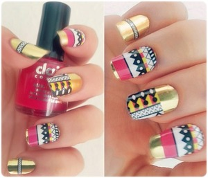 My heart is beating like a jungle drum... ruggudumdumdum ... :) Gold nails with pink, black, white patterns!