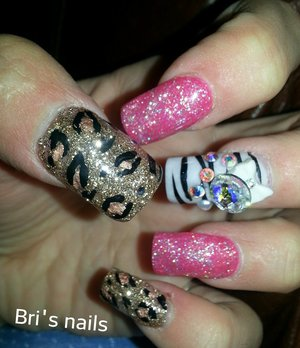 pink glitter,white zebra,and gold cheetah design on acrylic nails w white 3d bow big Swarovski stone and crystals
