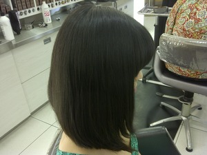 I had to respect my client's wish to not photograph her face, so I couldn't get a shot of her awesome bangs!  But she went from long locks, to this beautiful, and stylish long a-line bob haircut which I love!  She looked, and felt fabulous.  I LOVE doing haircuts!