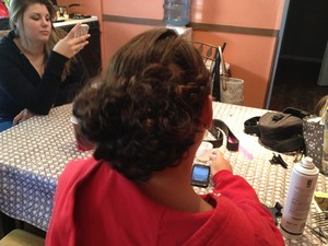 This is a hairstyle I did for prom :) it was a side French braid into a curly bun