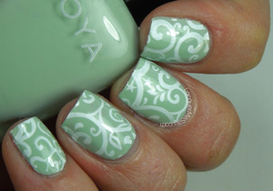 Stamp manicure using Zoya Neely and Pueen stamping plate. More info can be found on my blog: http://www.lacquermesilly.com/2014/03/29/stamping-saturday-5/