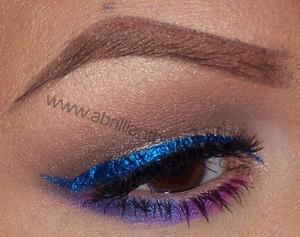 http://www.abrilliantbrunette.com/2012/08/drugstore-makeup-look-colorful-eyeliner.html