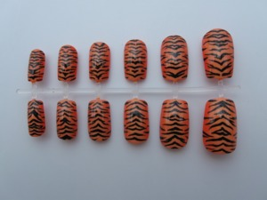 Buy them here: http://www.etsy.com/listing/107692389/tiger-print-nail-set