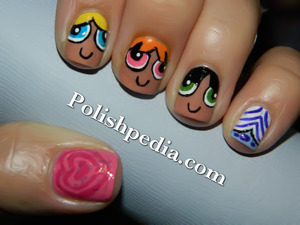 This design was done by request and we are super pumped about how they turned out!  See more on this design @ http://polishpedia.com/powerpuff-girls-nails.html