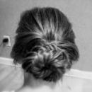 Fishtailed hair to a bun