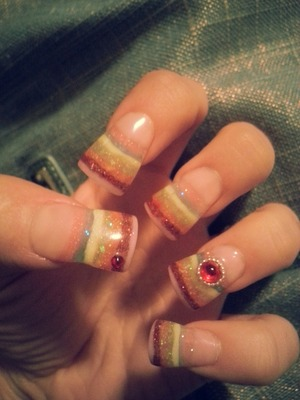 rainbow flare nails with red swarovski crystals
