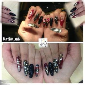 Stiletto nails with black glitter , red , gold stripes , matte black