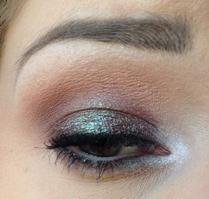 """-Butter London Wink Cream Eye Shadow in """"Jaded Jack"""" as a base for the eyelid -Kat Von D Shade Shifter Eye Shadow in """"On the Road"""" on the lid and lower lash line -""""Taupe"""" and """"Mauve"""" from the Lorac Pro palette in the crease and blended toward the brow -""""White"""" and """"Cream"""" from the Lorac Pro palette to highlight the brow bone -""""Nude"""" from the Lorac Pro palette to highlight the inner corner"""