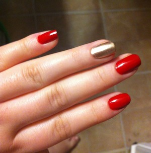 Love simple red nails and tried to make them a bit more fun by making one nail gold