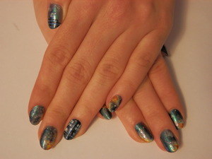 Galaxy nails featuring accent nails with the Doctor's famous blue box!
