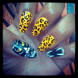 Leopard print, fangs, panther, Oh my!