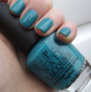 A bright full coverage turquoise