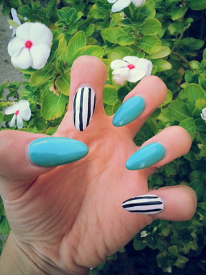 TEAL NAILS POLISH PAINTED OVER ACRYLIC NAILS W/ WHITE NAILS AND BLK STRIPES