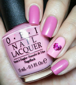The heart on the accent nail is made up of magenta hex glitters :)