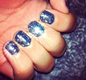 Dark tealish blue color with gold glitter specks.  (OPI - Ski Teal We Drop, Sephora by OPI - Only Gold For Me)
