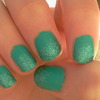 Treasure Island on top of green nail polish