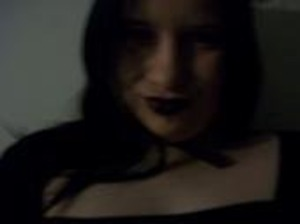 The lighting was dark in this old photo of me sitting the mood of Mistress of Darkness.