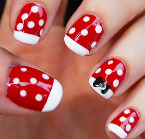 Minnie Mouse Nails Tutorial: http://www.youtube.com/watch?v=t91psb6Rvus - I used: base coat, red, white and black nail polish, dotting tool, rhinestones and top coat.  For especific brands/names please watch my tutorial.