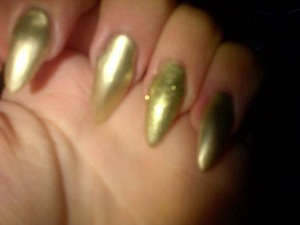 my friends sister did my nails for me they were a tad long but i filed them down and added one gold stud to the ring fingers at the tip but I do not have a picture