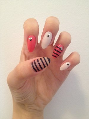 Natural stiletto nails with gems and free hand painted stripes