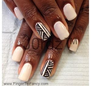 http://fingertipfancy.com/black-white-tribal-nails