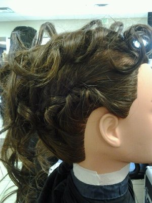 curly mohawk updo with braids down the sides