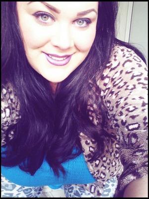 Purple tint hair with matching lipstick