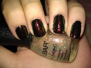 I searched everywhere for Sally Hansen Hidden Treasure but I'm glad I found this less expensive dupe instead. This is Nubar 2010 over a regular black nail polish. I adore it. It's the best flakie I own. It flashes red, orange and green when over black. Love love. I'll have to layer it over other colors soon.
