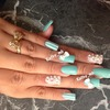 Bow nails with pearls