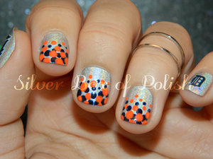 Polka dot gradient French tips inspired by the Detroit Tigers.