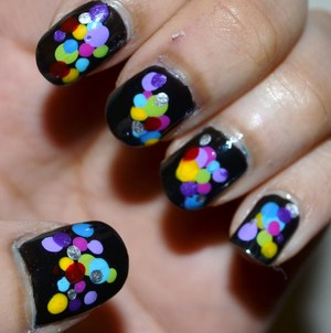 It's easy, paint nails black. Dot all of the colors.  For more pictures check out:  http://mishmreow.blogspot.co.uk