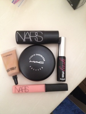 "These are my ""on the go"" favorites! I keep it as simple as possible when I don't have the time to get doll'd up.  A lilttle concealer, powder, mascara, lip gloss (Turkish Delight) and the multiple stick in ""orgasm"" by NARS...I'm one happy girl."