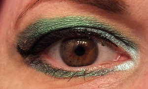 Outer V and outer lower lash line is Chaos Cosmetics Alter Ego, a deep grey with green sheen. Crease and outer to middle lower lash line is Oscar by Spectrum Cosmetics Lid and inner lower lash line is Serenity by Spectrum Cosmetics. Inner V is Hydra by Spectrum Cosmetics