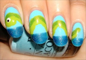 Loch Ness Monster Nails Nail tutorial & more photos here: http://www.swatchandlearn.com/nail-art-tutorial-loch-ness-monster-nails/