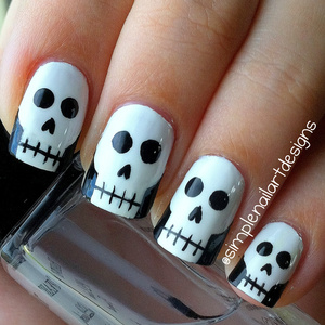 Skull nails for Halloween! There is a tutorial for this nail design on my youtube channel, simplenailartdesigns