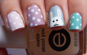 Easter bunny and polka dots! http://thepolishwell.blogspot.com/2012/04/nail-ideas-easter.html