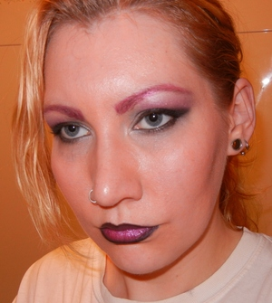 smokey eye with red brows, and boldly lined lips.