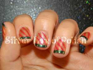A holiday manicure with green French tips and stamped stripes.