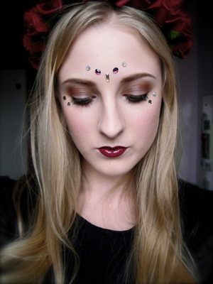 Decorated around the eyes with Sacred Stones by Illamasqua made by Swarovski from the Sacred Hour collection