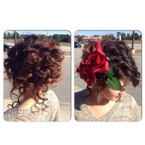 Loose curls pinned up and tendril to make it look more relaxed