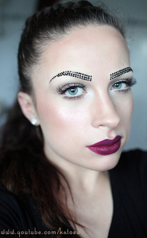 Bejewelled brows and berry lips