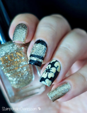 http://stampoholicsdiaries.com/2016/02/17/black-and-gold-flower-nails-with-born-pretty-nail-vinyls/